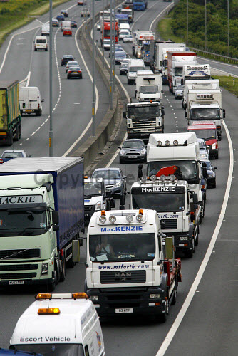 Fuel protestors take to the M8 between Glasgow and Edinburgh on a go-slow to highlight the anger over the rising costs of petrol and diesel in Britain. An estimated 100 HGV's took part in the convoy which led to long jams on the main route between Scotland's largest cities. PIC: GARRY MCHARG/SCOTTISH VIEWPOINT Tel: +44 (0) 131 622 7174   Fax: +44 (0) 131 622 7175 E-Mail : info@scottishviewpoint.com This photograph cannot be used without prior permission from Scottish Viewpoint. protest,demonstration,jam,traffic,cars,lorry,lorries