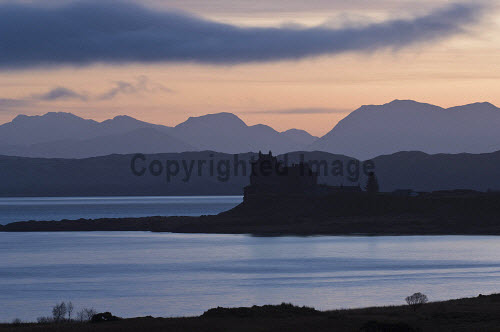 Duart Castle, Isle of Mull, Inner Hebrides.  Photographed at dawn, with the mainland hills in the background. The castle is the ancient seat of Clan MacLean.  PIC: ALAN GORDON/SCOTTISH VIEWPOINT Tel: +44 (0) 131 622 7174  Fax: +44 (0) 131 622 7175 E-Mail : info@scottishviewpoint.com This photograph cannot be used without prior permission from Scottish Viewpoint. Scotland,Mull,Island,sunrise,loch,mountains,wild,historic,building,argyll,atmospheric,silhouette ALAN GORDON/SCOTTISH VIEWPOINT