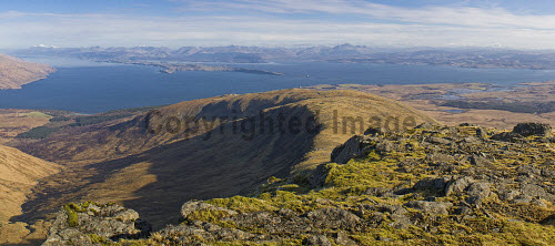 Loch Linhhe, the island of Lismore and the mainland hills from the east ridge of Mainnir nam Fiadh, Isle of Mull.  Ben Nevis is the snow-capped peak on the left, with Ben Cruachan to the right of centre and Oban on the far right.   The Torosay transmitter mast lies lower down on the ridge, with Duart Castle on the shore below.  Picture Credit: Alan Gordon /Scottish Viewpoint Tel: +44 (0) 131 622 7174   Fax: +44 (0) 131 622 7175 E-Mail : info@scottishviewpoint.com This photograph cannot be used without prior permission from Scottish Viewpoint. Scotland,Scottish,Highlands,Mull,Oban,Munros,mountains,peaks,hills,boulders,rocks,crags,cliffs,loch,sea,island,wild,wilderness,spring,sun,mast,transmitter,walking,climbing,trekking,backpacking,outdoor,activities,tourist,destinations,scenic,panoramic -