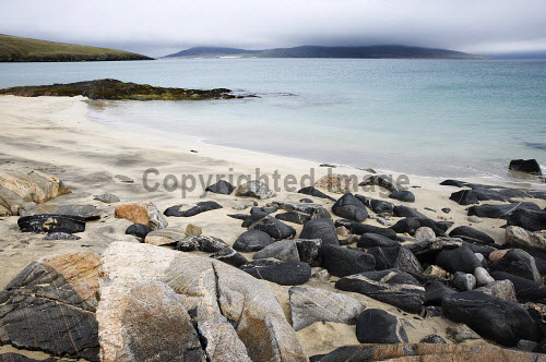 The turquoise water lapping gently onto the beach at Scarasta, Harris, Outer Hebrides.  Picture Credit: Richard Burdon / Scottish Viewpoint Tel: +44 (0) 131 622 7174   Fax: +44 (0) 131 622 7175 E-Mail : info@scottishviewpoint.com This photograph cannot be used without prior permission from Scottish Viewpoint. Scotland,Scottish,deserted,landscape,coastal,undiscovered,beach,sand,rocks,holiday,tranquil,dunes,south,Harris,Sheilebost,Losgaintir,seilebost,traigh,western isles