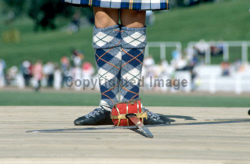 Traditional Scottish Highland dancing competition at the Pitlochry Highland Games. Picture Credit : Jason Baxter / Scottish Viewpoint  Tel: +44 (0) 131 622 7174  Fax: +44 (0) 131 622 7175  E-Mail : info@scottishviewpoint.com  Web: www.scottishviewpoint.com This photograph cannot be used without prior permission from Scottish Viewpoint. summer,sunny,girl,dance,dancer,skirt,tartan,dress,dresses,pattern,competition,compete,competitors,competitor,balance,co-ordination,co-ordinated,poise,perform,colourful,attraction,tourism,heritage,cultural,activity
