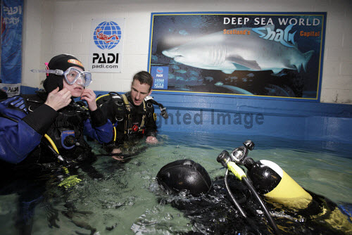 Divers kit-up before entering the aquarium at Deep Sea World to dive with the Sand tiger sharks, North Queensferry, Fife, Scotland. Picture Credit : Gary Doak / Scottish Viewpoint  Tel: +44 (0) 131 622 7174  Fax: +44 (0) 131 622 7175  E-Mail : info@scottishviewpoint.com  Web: www.scottishviewpoint.com This photograph cannot be used without prior permission from Scottish Viewpoint. aquarium,attraction,visitor,swimming