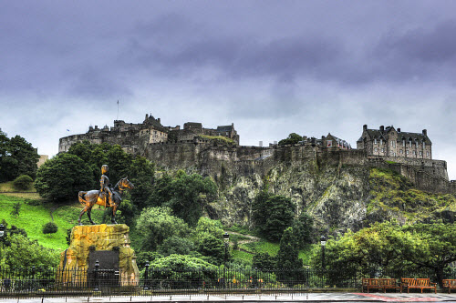 Edinburgh Castle from Princes Street with the Royal Grey Scots statue in the foreground.