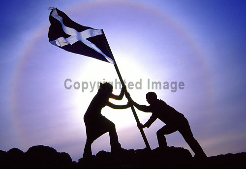 The saltire flag being raised in Edinburgh