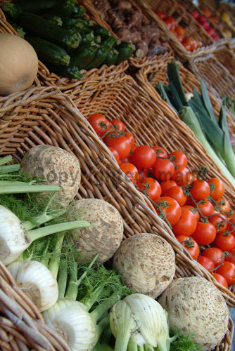 A DETAIL OF AN ASSORTMENT OF FRESH VEGETABLES IN WICKER BASKETS AT THE DELICATESSEN, DELIZIQUE ON HYNDLAND STREET, GLASGOW.