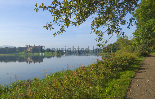 The view across Linlithgow Loch to St Michael's Parish Church and Linlithgow Palace, Linlithgow, West Lothian. 2013,autumn,sunny,water,reflection,reflections,path,footpath,walking,building,religion,attraction,visitor,tourist,history,heritage,historic,scotland,hs