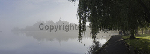 The view across a misty Linlithgow Loch to Linlithgow Palace and St Michael's Parish Church, Linlithgow, West Lothian. 2013,autumn,atmospheric,silhouette,mist,fog,foggy,bird,birds,duck,ducks,water,building,religion,attraction,visitor,tourist,history,heritage,historic,scotland,hs,panoramic,path,footpath,walking,people