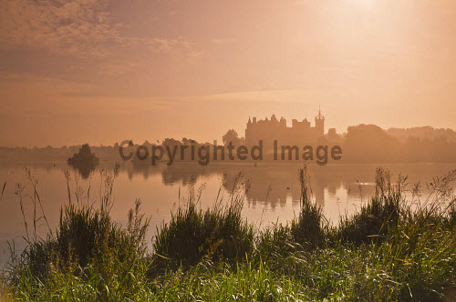 The view across a misty Linlithgow Loch to Linlithgow Palace and St Michael's Parish Church, Linlithgow, West Lothian. 2013,autumn,atmospheric,silhouette,mist,fog,foggy,water,building,religion,attraction,visitor,tourist,history,heritage,historic,scotland,hs,path,footpath,walking