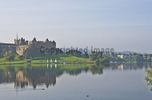 The view across Linlithgow Loch to St Michael's Parish Church and Linlithgow Palace, Linlithgow, West Lothian. 2013,summer,sunny,water,reflection,reflections,building,religion,attraction,visitor,tourist,history,heritage,historic,scotland,hs,activity,activities,sailing,boat,boats,dinghy,dinghies