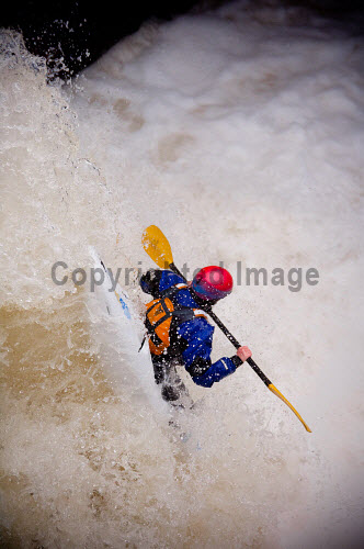 A kayaker plunging down the Lower Falls, in the River Nevis, Glen Nevis, Highlands of Scotland. autumn,activity,activities,kayak,kayaks,kayaker,kayakers,paddle,paddling,sport,people,water,dramatic,extreme,splash,fall,plunge,plunging