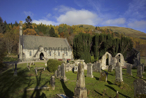Balquhidder Parish Church with the ruins of the Old Church visible - the graveyard contains the grave of Rob Roy MacGregor. autumn,sunny,sunshine,hill,hills,tree,trees,wood,woodland,woods,grave,graves,graveyard,gravestone,gravestones,religion,attraction,attractions,visitor,tourist