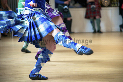 A detail of a competitor taking part in a Highland Dancing competition. 2013,interior,detail,competitor,competitors,Highland,Dancing,compete,competition,kilt,kilts,tartan,sock,socks