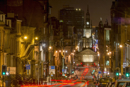 The view along West George Street to St George's Tron Parish Church at night in the city centre of Glasgow. 2013,glasgow,city,strathclyde,scotland,scottish,urban,west,george,saint,st,georges,tron,parish,church,spire,steeple,religion,street,night,lights,streetlights,car,cars,traffic,tail,trails,architecture,architectural,building,buildings