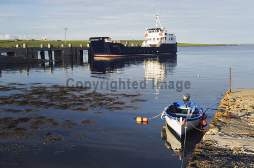 The MV Shapinsay Orkney Islands Council ferry at the harbour at Balfour, Shapinsay, Orkney. Picture Credit : Iain Sarjeant / Scottish Viewpoint  Tel: +44 (0) 131 622 7174  E-Mail : info@scottishviewpoint.com  Web: www.scottishviewpoint.com This photograph cannot be used without prior permission from Scottish Viewpoint. 2012,summer,sunny,island,islands,isle,isles,coast,coastal,coastline,water,sea,boat,boats,reflection,village