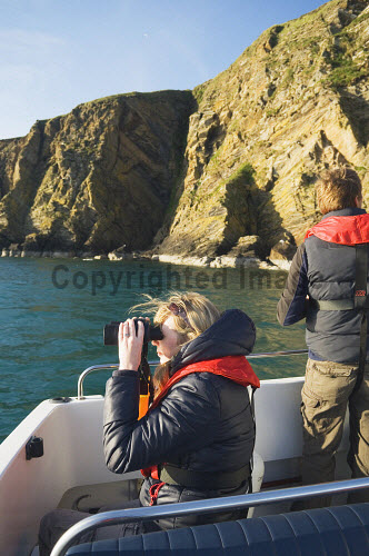 Birdwatchers on a Scapa Flow Boat trip, Orkney. Picture Credit : Iain Sarjeant / Scottish Viewpoint  Tel: +44 (0) 131 622 7174  E-Mail : info@scottishviewpoint.com  Web: www.scottishviewpoint.com This photograph cannot be used without prior permission from Scottish Viewpoint. 2012,summer,sunny,island,islands,isle,isles,activity,activities,hobby,hobbies,coast,coastal,coastline,water,sea,binoculars,twitching,twitchers,wildlife,people,person,couple