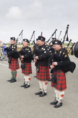 Pipe band at the Sanday Soulka, Sanday, Orkney. Picture Credit : Iain Sarjeant / Scottish Viewpoint  Tel: +44 (0) 131 622 7174  E-Mail : info@scottishviewpoint.com  Web: www.scottishviewpoint.com This photograph cannot be used without prior permission from Scottish Viewpoint. 2012,summer,sunny,island,islands,isle,isles,event,festival,tartan,kilt,kilts,bagpipes,piper,pipers