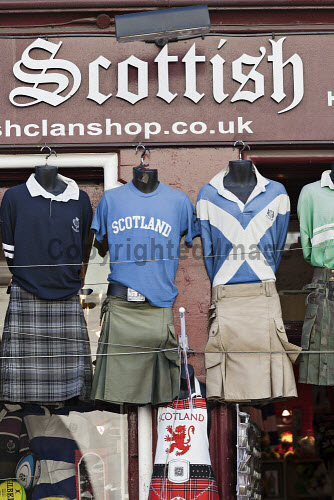 Kilts and tartan outside a Scottish souvenir shop on the Royal Mile, Edinburgh,  Lothian, Scotland Scottish,souvenir,shop,souvenirs,gift,gifts,kilt,kilts,sporran,tartan,tat,tourism,rugby,shirt,top,saltire,plaid,Royal,Mile,High,Street Canongate,Edinburgh,sunny,summer,shopping,scotland,uk,u.k,great,britain