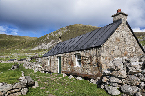 A restored house in the village, Hirta,  St Kilda archipelago, Outer Hebrides, Scotland history,heritage,historic,Scotland,Scottish,UK,U.K,Great Britain,nobody,outdoors,daytime,summer,sunny,world heritage site,island,islands,isle,isles,hirta,St Kilda,restored,house,village,main street,national nature reserve