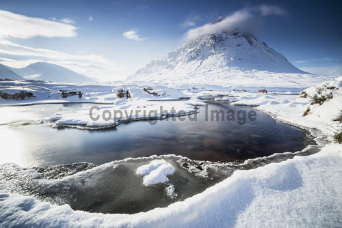Buachaille Etive Mor, with a partly frozen River Coupall in the foreground, Glen Coe, Highlands of Scotland. horizontal,outdoors,outside,day,winter,blue sky,Buachaille Etive Mor,River Coupall,Glen Coe,Highlands,Scotland,Scottish,UK,U.K,Great Britain,nobody,water,flow,snow,snowy,ice,frozen,atmospheric,mountain,munro