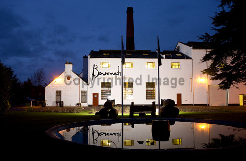 The Benromach distillery - a Speyside single malt Scotch whisky distillery in Forres, photographed at duskMoray, Scotland. horizontal,outside,outdoors,exterior,winter,dusk,evening,night,Benromach Distillery,Forres,Moray,Scotland,Scottish,UK,U.K,Great Britain,nobody,attraction,building,single malt,whisky,production,Speyside,atmospheric,reflection