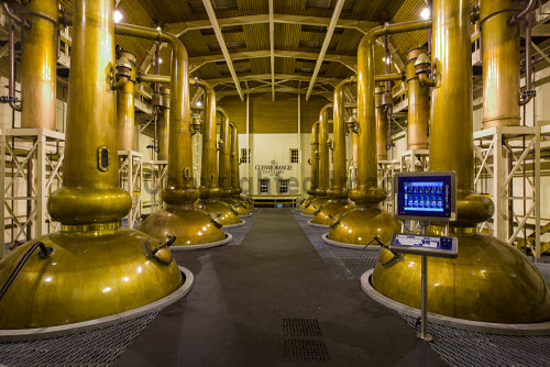 Copper Stills of the Glenmorangie Whisky Distillery, Tain, Scottish Highlands inside,interior,indoors,stillroom,Glenmorangie Distillery,Tain,Highlands,Scotland,Scottish,UK,U.K,Great Britain,nobody,single malt,whisky,still,vat,copper,spirit,whiskey John Paul Photography