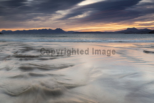 The ebb and flow of the tide at the beach by Mellon Udrigle at dawn with a view to the mountains beyond, Wester Ross, Highlands of Scotland highlands,atmospheric,scotland,scottish,uk,u.k,great,britain,nobody,outddoors,daytime,sea,spring,beach,bay,coast,coastal,coastline,water,remote,beaches,dawn,Mellon Udrigle,sand,sandy,patterns,texture,tidal,tide