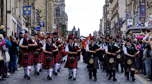 Pipefest 2015 - Massed Pipe Bands march down the Royal Mile in Edinburgh during the festival 2015, Scotland 2015,Ceremony,Fringe,Kilt,Massed Bands,Pipe Band,PipeFest,Pipers,bagpipes,drummers,drums,highland dress,music,pageant,pipes,royal mile,spectacle,kilts,tartan