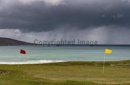 A squall heading towards Toe Head viewed from the golf course at Scarista on the Isle of Harris, Outer Hebrides, Scotland uk,u.k,Great Britain,GB,G.B,Scotland,Scottish,nobody,daytime,outdoors,Chaipeval,Harris,Outer Hebrides,Scarasta,Spring,Toe Head,golf course,scarista,storm,western isles,coast,coastal,coastline,water,sea