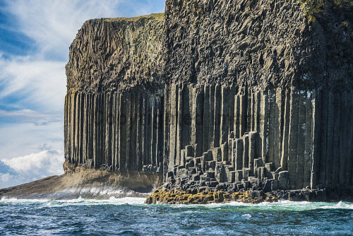 The cliffs by Fingal's Cave and the Boat Cave, showing basalt columns and the overlying basalt lava flow, Isle of Staffa, Inner Hebrides, Scotland uk,u.k,Great Britain,GB,G.B,Scotland,Scottish,nobody,daytime,outdoors,island,islands,isle,isles,coast,coastal,coastline,water,sea,staffa,basalt,inner hebrides,summer