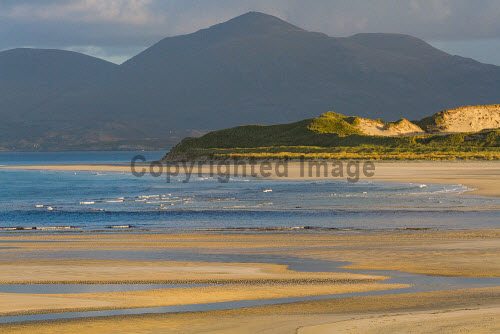 Morning light over Luskentyre beach on South Harris in the Outer Hebrides, Scotland uk,u.k,Great Britain,GB,G.B,Scotland,Scottish,nobody,daytime,outdoors,Outer Hebrides,western isles,harris,island,islands,isle,isles,mountain,mountains,hill,hills,Luskentyre,beach,beaches,sand,sandy,coast,coastal,coastline,water,sea,autumn