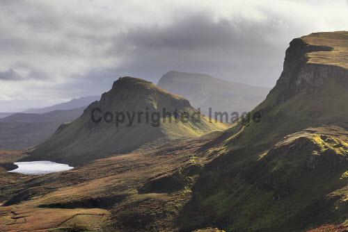 Trotternish Ridge near the Quiraing on the Isle of Skye, Inner Hebrides, Scotland uk,u.k,Great Britain,GB,G.B,Scotland,Scottish,nobody,daytime,outdoors,autumn,autumnal,coast,coastal,coastline,water,mountain,mountains,hill,hills,island,islands,isle,isles,skye,inner hebrides,trotternish ridge,quiraing