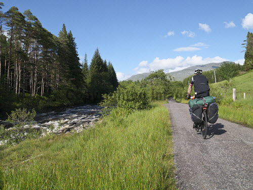 Male cyclist touring along Glen Orchy, Scotland uk,u.k,Great,Britain,GB,G.B,Scotland,Scottish,1 person,daytime,outdoors,road,rural,activity,activities,cycling,cyclist,cyclists,bike,bikes,biking,biker,bikers,bicycle,bicycles,mountain,path,glen orchy,highland,highlands