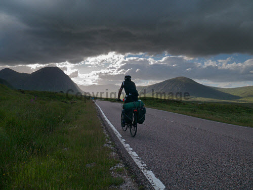 Male cyclist crossing Rannoch Moor on A82, Highlands of Scotland uk,u.k,Great,Britain,GB,G.B,Scotland,Scottish,1 person,daytime,outdoors,road,rural,activity,activities,cycling,cyclist,cyclists,bike,bikes,biking,biker,bikers,bicycle,bicycles,mountain,path,rannoch moor,highland,highlands