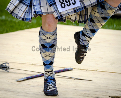 Peebles, Scotland UK  3rd September 2016. Peebles Highland Games, the biggest 'highland' games in the Scottish  Borders took place in Peebles on September 3rd 2016 featuring pipe band contests, highland dancing competitions, haggis hurling, hammer throwing, stone throwing and other traditional events.  Pictured:  Highland dancing competition in progress uk,u.k,Great Britain,GB,G.B,Scotland,Scottish,group,daytime,outdoors,Highland Games,competitions,borders,highland,dancing,dance,feet,legs,sword,tartan,kilts