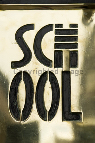 Art Nouveau style Brass door sign at famous Glasgow School of Art designed by Charles Rennie Mackintosh Architecture,Britain,Building,Glasgow,Art,Landmark,Scotland,United Kingdom,detail,education,historic,school,sign,entrance,heritage,Scottish,british,Europe,European,nouveau