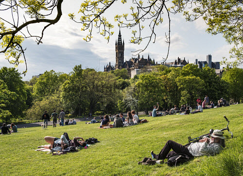 Students relaxing on lawns of Kelvingrove Park with Glasgow university in the distance in Scotland, United Kingdom Glasgow,Kelvingrove,park,university,students,parks,Scotland,Scottish,higher,education,universities,daytime,outdoors,city,cities,people,Britain,British,united,Kingdom,Europe,European,parkland