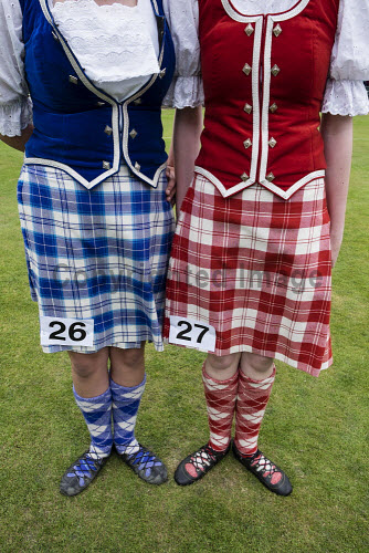 Female highland dancers in kilts before competition at  Braemar Junior Highland Games in July in Scotland United Kingdom Braemar,Junior,Highland,Games,Scotland,dancers,Scottish,detail,kilts,kilt,female,girls,ladies,women,competitors,dress,traditional,costume,skirts,standing,dancing,heritage,competition,dance,UK,United Kingdom,tartan