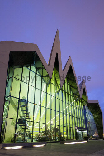 Dusk view of new Riverside Museum of Transport in Glasgow Scotland UK Architect Zaha Hadid Architecture,Building,Evening,Exterior,Glasgow,Zaha Hadid,Modern,New,Night,Scotland,cities,city,dusk,museum,museums,riverside,transport
