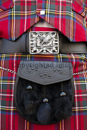 Close up of traditional Scottish tartan kilt and sporran Scottish,kilt,tartan,sporran,scotland,traditional,clothing,plaid,red,culture,kilts,detail,cultural,clothes,male,mens