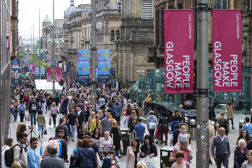 View of shoppers on busy Buchanan Street, popular shopping street,  in central Glasgow United Kingdom Glasgow,Buchanan,street,streets,busy,people,crowd,crowds,crowded,shops,shopping,shoppers,pedestrians,Scotland,Scottish,retail,store stores,daytme,exterior,Britain,city,cities,United Kingdom,British,Europe,european,urban,scene,modern,consumerism,retailers,pedestrianised,outdoor