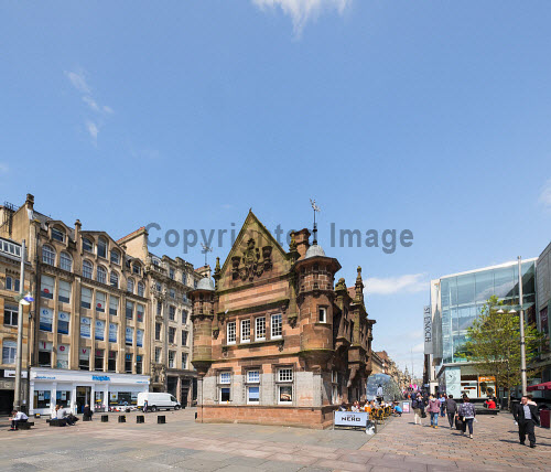Former underground station office and entrance at  St Enoch Square in Glasgow, Scotland, United Kingdom Glasgow,St Enoch,Square,city,urban,scene,street,subway,metro,station,Scotland,Scottish,building,exterior,United Kingdom,Europe,European,daytime,outdoor,architecture,entrance,people