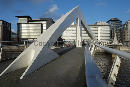 Tradeston Footbridge across River Clyde in Glasgow Scotland UK Clyde,Glasgow,Scottish,Scotland,Squiggly,bridges,cities,city,footbridge,river,bridge