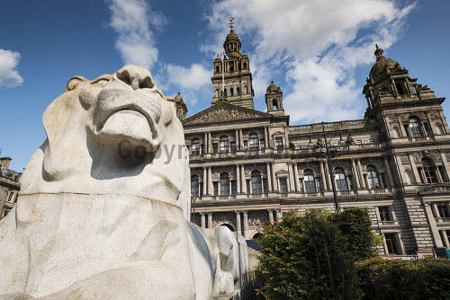 View of Lion Statue in front of City Chambers in George Square Glasgow , united Kingdom George,Square,Glasgow,city,chambers,town,hall,statue,landmark,Scotland,Scottish,daytime,exterior,nobody,building,heritage