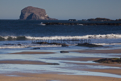 The Bass Rock and North Berwick beach, East Lothian, Scotland uk,u.k,Great Britain,GB,G.B,Scotland,Scottish,nobody,daytime,outdoors,east lothian,coast,coastal,coastline,water,sea,north berwick,bass rock,beach