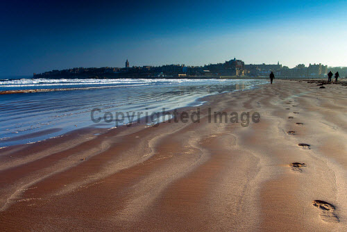 Footprints and walkers on West Sands, St Andrews, Fife, Scotland uk,u.k,Great Britain,GB,G.B,Scotland,Scottish,group,daytime,outdoors,fife,coastal,path,coast,coastline,water,sea,st andrews,beach,west sands,footprints,sand,sandy
