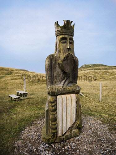 Chessman Sculpture at Uig Beach Isle of Lewis Outer Hebrides , Scotland uk,u.k,Great Britain,GB,G.B,Scotland,Scottish,nobody,daytime,archaeology,ardroil,beach,blue,carving,chessman,chessmen,commission,commissioned,community,council,crown,dunes,famous,figural,figure,gaelic,hebrides,historic,historical,history,icon,iconic,island,islands,isle,isles,king,lewis,machair,mediaeval,norway,norwegian,outer,piece,sand,scots,sculpture,sky,summer,tourism,trondheim,uig,western,wood,wooden