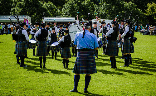 Peebles, Scotland UK 2nd September 2017. Peebles Highland Games, the biggest 'highland' games in the Scottish Borders took place in Peebles on September 2nd 2017 featuring pipe band contests, highland dancing competitions, haggis hurling, hammer throwing, stone throwing and other traditional events. uk,u.k,Great Britain,GB,G.B,Scotland,Scottish,group,daytime,outdoors,2017,Highland Games,Pipe Band,bagpipes,bagpipe,pipe,pipes,tartan,kilts