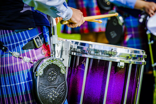 Peebles, Scotland UK 2nd September 2017. Peebles Highland Games, the biggest 'highland' games in the Scottish Borders took place in Peebles on September 2nd 2017 featuring pipe band contests, highland dancing competitions, haggis hurling, hammer throwing, stone throwing and other traditional events. uk,u.k,Great Britain,GB,G.B,Scotland,Scottish,group,daytime,outdoors,2017,Highland Games,Pipe Band,tartan,kilts,kilt,detail,rum,drumming