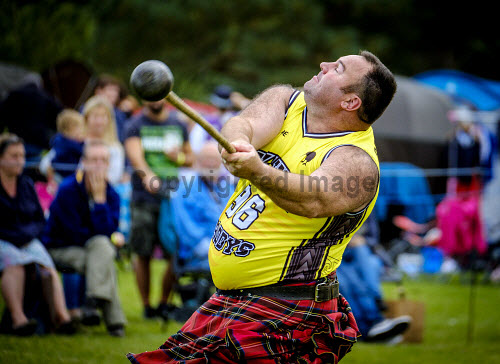 Peebles, Scotland UK 2nd September 2017. Peebles Highland Games, the biggest 'highland' games in the Scottish Borders took place in Peebles on September 2nd 2017 featuring pipe band contests, highland dancing competitions, haggis hurling, hammer throwing, stone throwing and other traditional events. uk,u.k,Great Britain,GB,G.B,Scotland,Scottish,group,daytime,outdoors,2017,Highland Games,Pipe,tartan,kilts,throwing,throw,hurl,competitor
