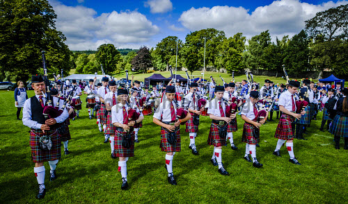 Peebles, Scotland UK 2nd September 2017. Peebles Highland Games, the biggest 'highland' games in the Scottish Borders took place in Peebles on September 2nd 2017 featuring pipe band contests, highland dancing competitions, haggis hurling, hammer throwing, stone throwing and other traditional events. uk,u.k,Great Britain,GB,G.B,Scotland,Scottish,group,daytime,outdoors,2017,Highland Games,Pipe Band,bagpipes,bagpipe,pipe,pipes,tartan,kilts,spectators